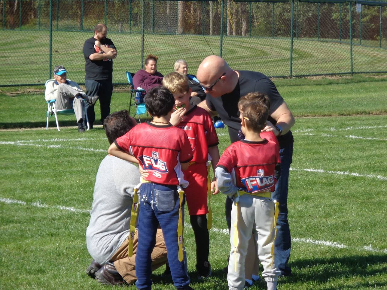 Volunteer coachings flag football players