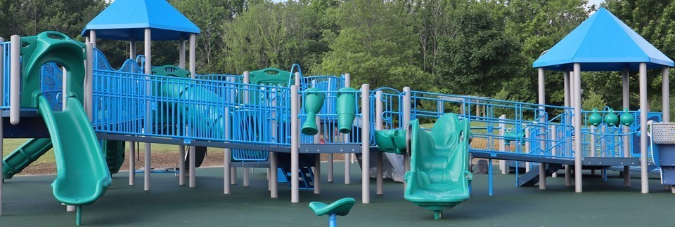 New blue, green and tan playground with slides